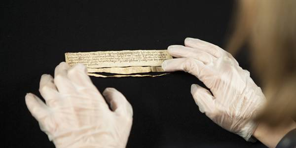 The William Charter being prepared for digitisation - the small physical size of the document belies its importance.